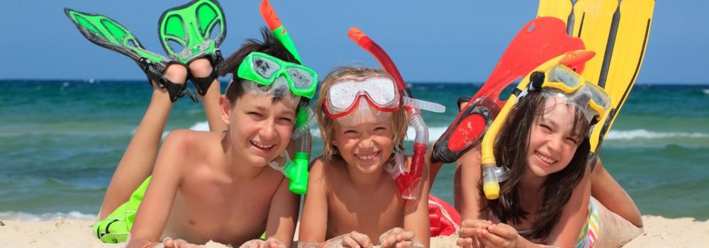 Three snorkeling kids